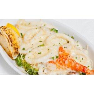 Запеченные кальмары в сливочном соусе под сыром